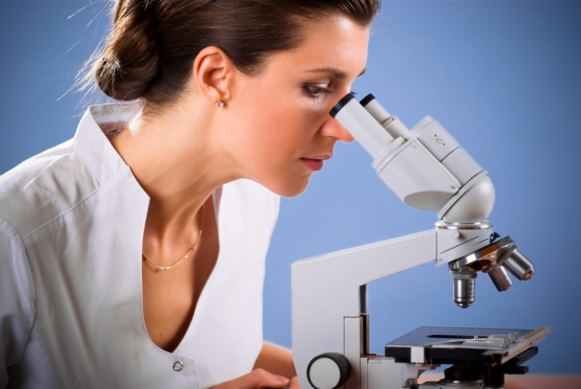 Female doctor working with a microscope